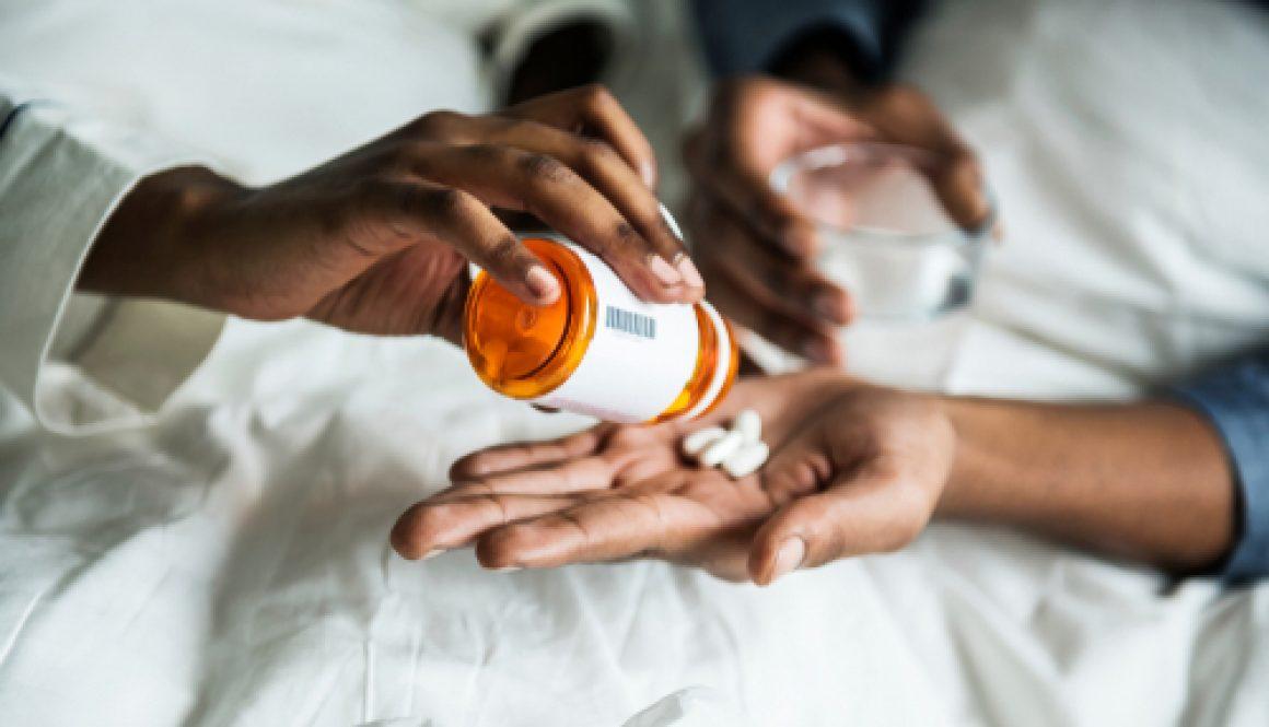 A,Woman,Handing,Pills,To,Her,Boyfriend