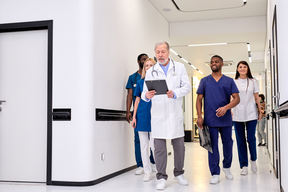 Group,Photo,Of,Young,Diverse,Medics,During,Conversation,With,Senior