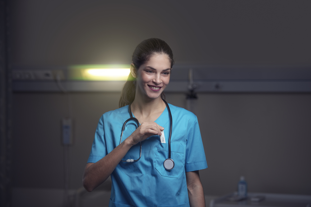Woman,Doctor,Or,Nurse,Is,Feeling,Satisfied,While,Working,Night