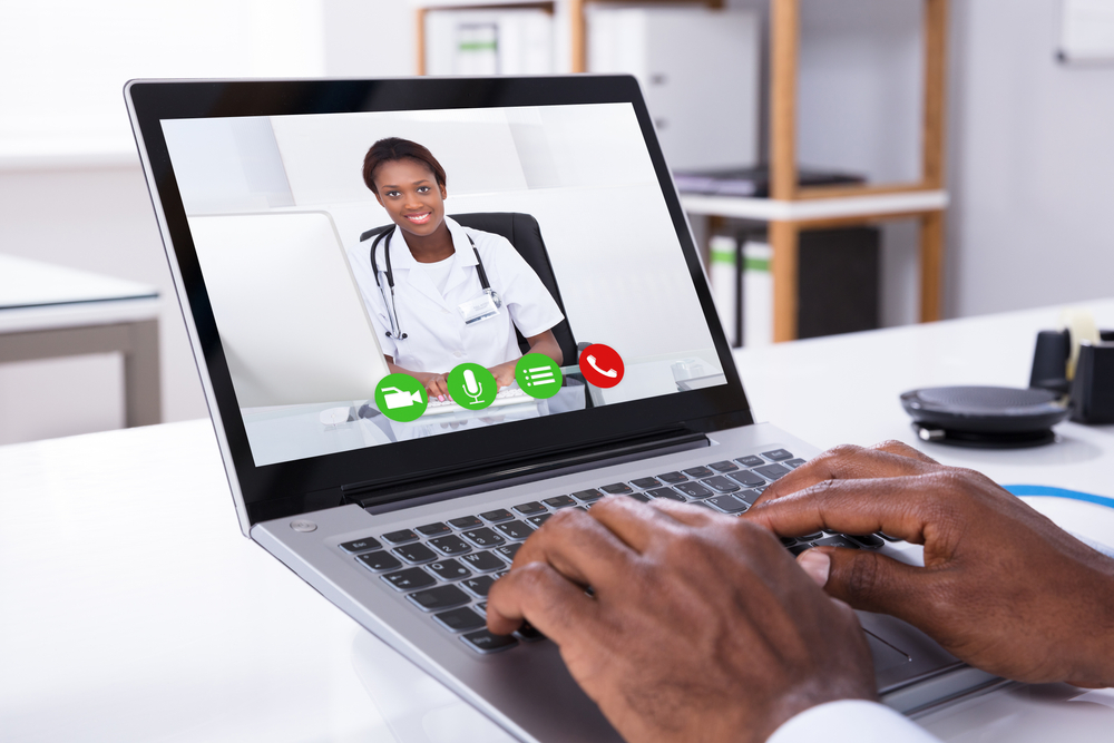 Close-up,Of,A,Person,Video,Conferencing,With,Female,Doctor,Through