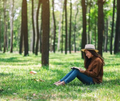 A,Beautiful,Asian,Woman,Reading,A,Book,While,Sitting,In