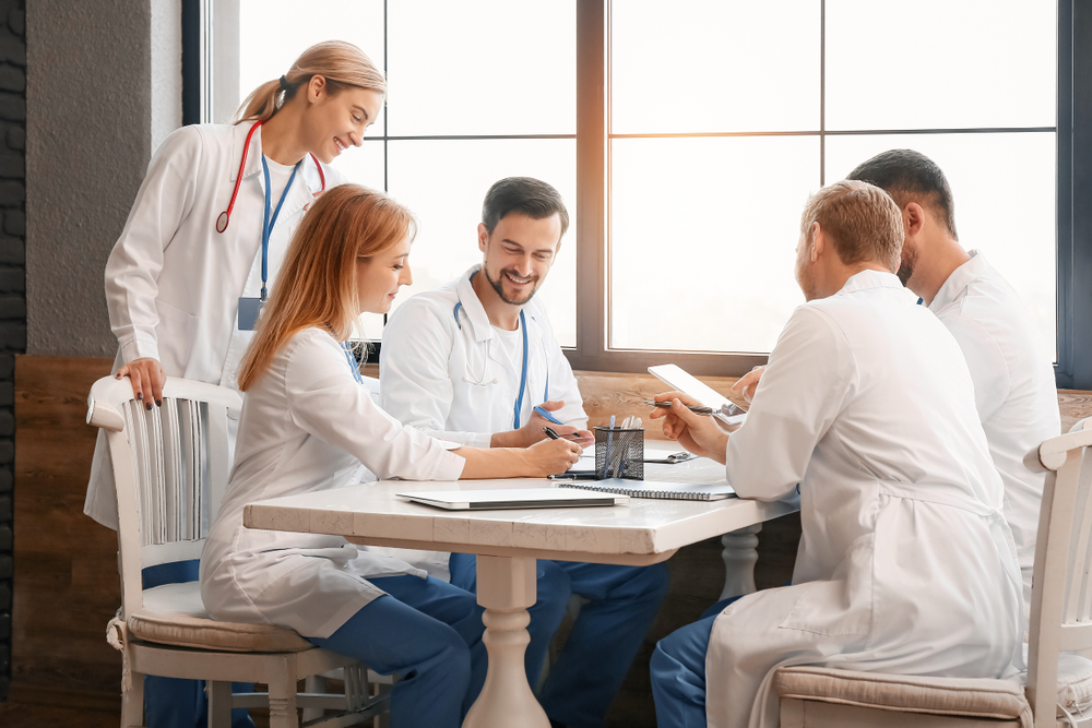 Doctors,At,Meeting,In,Modern,Clinic